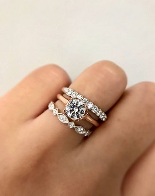 Coast Diamond stack of diamond rings with rose gold solitaire engagement ring