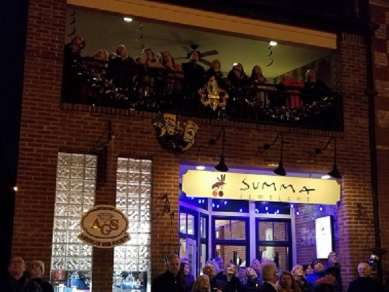 Summa Jewelers hosts Mardi Gras revellers.